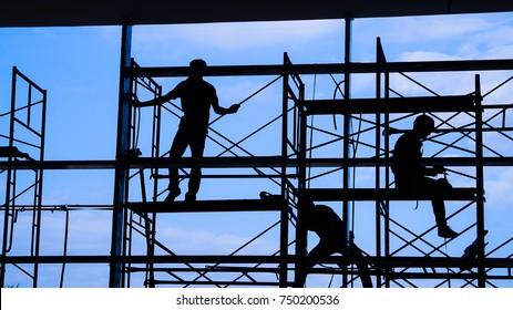 Woker silhouette on scaffold contruction safty working business