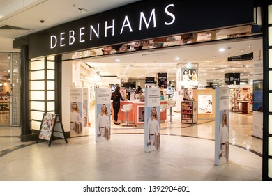 Woking / United Kingdom - 4/30/2019: The entrance to Debenhams department store in a shopping centre