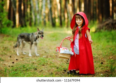 "the wolf pursues the girl.  the fairy tale "" Red Riding Hood"""