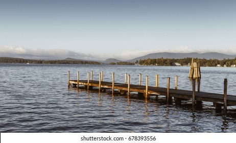 Wolfeboro N.H. town docks reaching out into Lake Winnipesaukee on an early summer morning