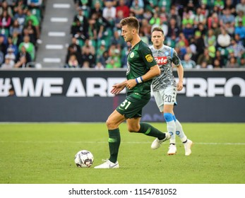 Wolfsburg, Germany, August 11, 2018: soccer player, Robin Knoche, kicking the ball during a match at Volkswagen Arena in Wolfsburg, Germany.