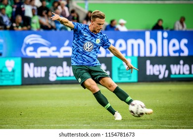 Wolfsburg, Germany, August 11, 2018: football player Yannick Gerhardt kicking the ball during warm-up session before a friendly match at Volkswagen Arena on August 11, 2018 in Wolfsburg, Germany.