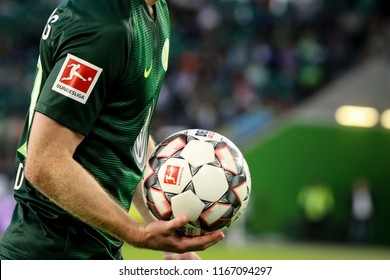 Wolfsburg, Germany, August 11, 2018: soccer player, Maximilian Arnold, take the official bundesliga ball in the 2018-2019 season.