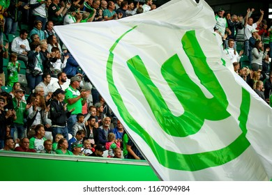 Wolfsburg, Germany, August 11, 2018: white and green flag around the VfL Wolfsburg fans during a match at Volkswagen Arena in Wolfsburg.