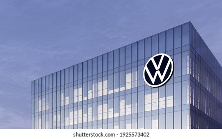 Wolfsburg, Germany. February 27, 2021. Editorial Use Only,  Volkswagen Automaker Corporation Motors Signage Logo on Top of Glass Building. Workplace VW Car Company Office Headquarter.
