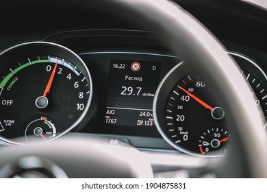 Wolfsburg, Germany - June 19, 2016: Volkswagen VW e-Golf electric car on the city streets, close view of the steering wheel and dashboard. Volkswagen is a German car manufacturer headquartered in