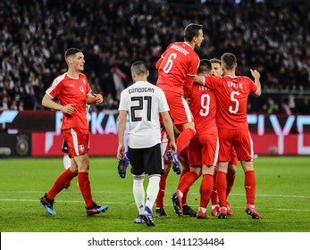 Wolfsburg, Germany, March 20, 2019: Serbian soccer players celebrating their first goal during the international friendly game Germany vs Serbia in Wolfsburg.