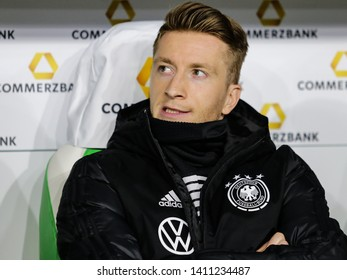 Wolfsburg, Germany, March 20, 2019: Germany national team footballer, Marco Reus, sitting on the bench during the international friendly soccer game Germany vs Serbia at Volkswagen Arena.