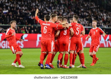 Wolfsburg, Germany, March 20, 2019: Serbian footballers celebrating a goal during the international friendly game Germany vs Serbia in Wolfsburg.