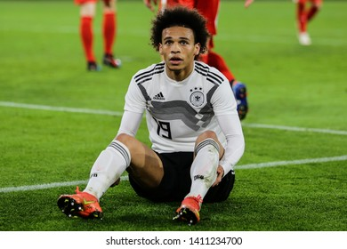 Wolfsburg, Germany, March 20, 2019: German footballer Leroy Sané on ground after a foul during international friendly game Germany vs Serbia in Wolfsburg.