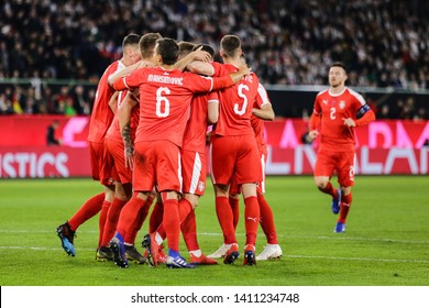 Wolfsburg, Germany, March 20, 2019: Serbian players celebrating their first goal during the international friendly game Germany vs Serbia in Wolfsburg.