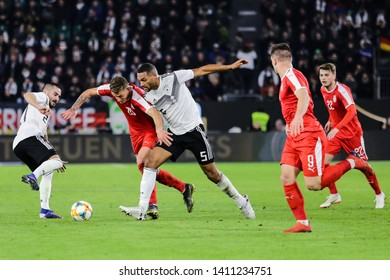 Wolfsburg, Germany, March 20, 2019: famous footballers Jonathan Tah and Sergej Milinkovic in action during the international friendly game Germany vs Serbia in Wolfsburg.