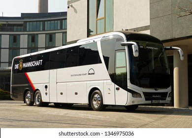 "WOLFSBURG, GERMANY - March 22, 2019: New team bus of german soccer team ""Die Mannschaft"" before leaving Wolfsburg after match against Serbia"