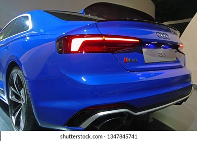 "WOLFSBURG, GERMANY - March 22, 2019: Audi RS5 closeup backside with lights and logo in showroom ""Autostadt Wolfsburg"""