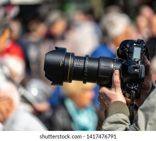 Wolfsburg, Germany, May 1, 2019: Reporter shots with a professional black photo camera