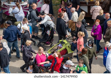 Wolfsburg, Germany, May 26., 2019: View from above of the fair at the Schützenfest in Wolfsburg with many people visiting the rides, lottery stalls and snack vendors.