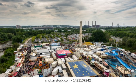 Wolfsburg, Germany, May 26., 2019: View from above of the fair at the Schützenfest, with the factories of the VW factory and the city of Wolfsburg in the background.