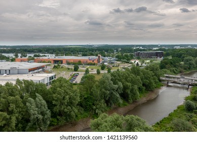 Wolfsburg, Germany, May 26., 2019: View from above of the Aller in the Allerpark Wolfsburg with the ice stadium and the Badeland in the background.
