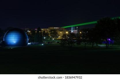 Wolfsburg Germany October 12 2020 : Planetarium in Wolfsburg at night with laser beam through the City from Phaeno