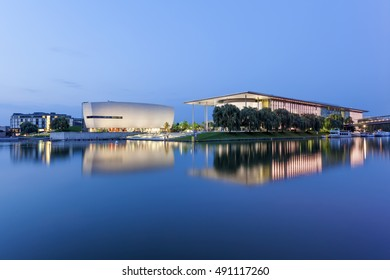 WOLFSBURG, GERMANY - SEP 23, 2016: Contemporary buildings at the Volkswagen Autostadt illuminated at night. Wolfsburg, Germany