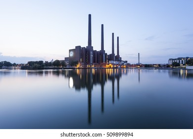 WOLFSBURG, GERMANY - SEP 23, 2016: View of the old Volkswagen factory buildings illuminated at night