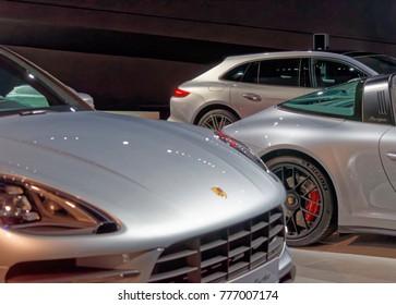 Wolfsburg, Lower Saxony, Germany, December 18 2017: Three Porsche models on display at the Porsche Pavilion in the Autostadt