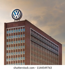 Wolfsburg, Lower Saxony, Germany, July 21., 2018: Main building of the administration of the VW Group in front of a dark cloudy sky.