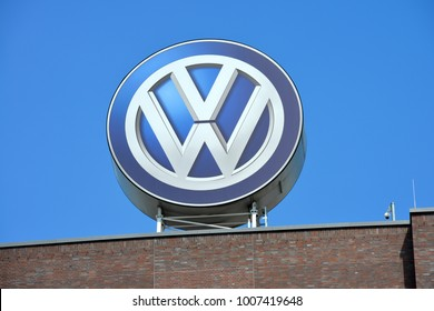 Wolfsburg, Lower Saxony / Germany - May 21, 2017: VW Logo on the roof of the headquarters of Volkswagen AG, Wolfsburg, Germany