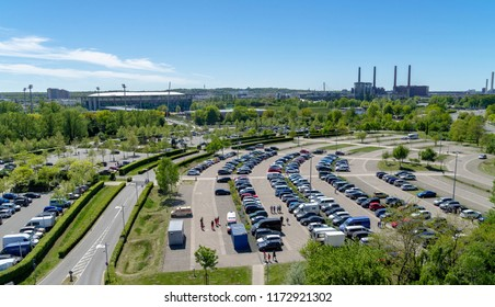 Wolfsburg, lower saxony, germany, May 5., 2018: Aerial view over a large parking lot with many parked cars onto a football stadium and the Volkswagen factory