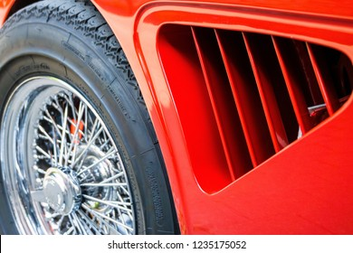 Wolfsburg, Lower Saxony, Germany, May 27, 2018: Close-up of the side air slits of a red painted sports car at an oldtimer meeting, Fallersleben