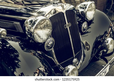 Wolfsburg, Lower Saxony, Germany, May 27, 2018: Close-up of the front of a black Horch 8 Type 350 from 1929 with chromed radiator grille at an oldtimer meeting, Fallersleben