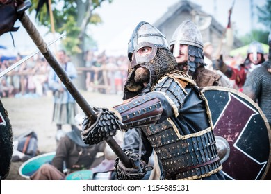 Wolin, Poland - August 02, 2014: 20 th Wolin Viking Festival.This is an important meeting point for Viking and Slav reenactors of Europe. Viking and Slav warrior in reenactment battle.