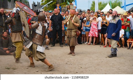 Wolin, Zachodniopomorskie, Poland - 08.05.2018: Two early medieval viking warriors fighting in a duel with sword and shield on the Festival of Slavs and Vikings on Wolin island in Poland.