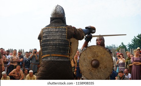 Wolin, Zachodniopomorskie, Poland - 08.05.2018: Two early medieval warriors fighting in a duel with sword and shield on the Festival of Slavs and Vikings on Wolin island in Poland.