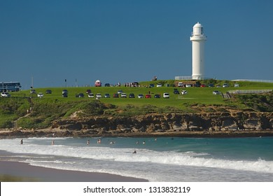 WOLLONGONG, AUSTRALIA - MARCH 25, 2016: People enjoying swimming in the ocean nearby Wollongong Lighthouse, Flagstaff Hill Park