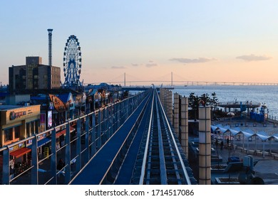 Wolmido Island, Jung-gu, Incheon, Korea - December 27, 2019: Light railway and a ferris wheel at the Wolmi Theme Park with the background of Seohaedaegyo Bridge