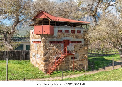 WOLSELEY, SOUTH AFRICA, AUGUST 8, 2018: One of two historic blockhouses, dating from the Anglo Boer War, at the railway bridge over the Breede River at Wolseley in the Western Cape Province