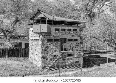 WOLSELEY, SOUTH AFRICA, AUGUST 8, 2018: One of two historic blockhouses, dating from the Anglo Boer War, at the railway bridge over the Breede River at Wolseley. Monochrome