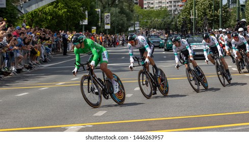 Woluwe-Saint-Pierre, Brussels, Belgium - July 07 2019: the BORA - HANSGROHE team sprint close up in the second stage of the Tour de France with Peter Sagan in the lead and crowds in the background
