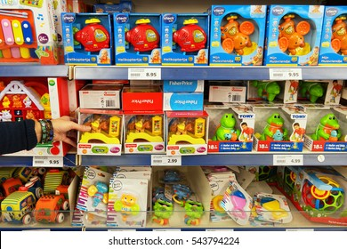 WOLVEGA, THE NETHERLANDS - DECEMBER 2, 2016: Toys from different brands in a toy store. Aisle with a variety of Toys in a Dutch Action Superstore.