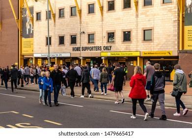 Wolverhampton, United Kingdom - August 15, 2019: Fans walking towards Molineux Stadium for the Wolves vs Pyunik Europa League football match.