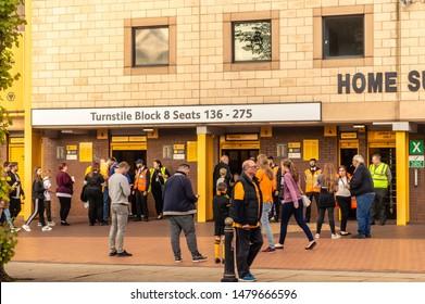 Wolverhampton, United Kingdom - August 15, 2019: Fans entering Molineux Stadium for the Wolves vs Pyunik Europa League football match.