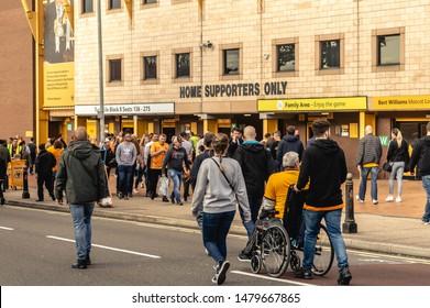 Wolverhampton, United Kingdom - August 15, 2019: A diverse bunch of fans walking towards Molineux Stadium for the Wolves vs Pyunik Europa League football match.