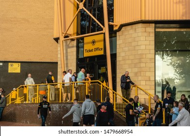 Wolverhampton, United Kingdom - August 15, 2019: Fans entering the ticket office at Molineux Stadium for the Wolves vs Pyunik Europa League football match.