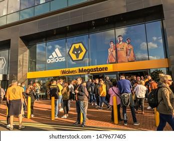 Wolverhampton, United Kingdom - August 15, 2019: Fans walking outside Wolves Megastore on match day (Wolves vs Pyunik Europa League)