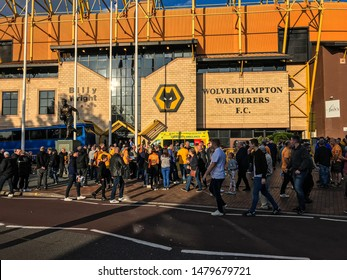 Wolverhampton, United Kingdom - August 15, 2019: Fans walking  in front of the Molineux Stadium on match day (Wolves vs Pyunik Europa League)