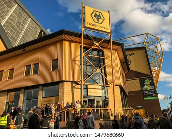 Wolverhampton, United Kingdom - August 15, 2019: Fans walking towards the ticket office at Molineux Stadium for the Wolves vs Pyunik Europa League football match.