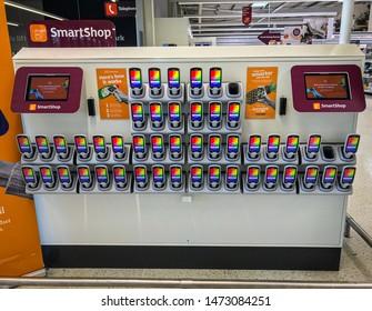 Wolverhampton, United Kingdom - August 5, 2019: The Sainbury's Wolverhampton SmartShop area. Customers tap the handset then use their nectar card to start smart shopping.