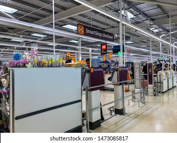 Wolverhampton, United Kingdom - August 5, 2019: A customer uses the SmartShop Checkout at Sainsbury's Wolverhampton