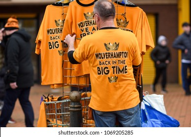 Wolverhampton,UK. April 15th 2018:Wolves fans celebrate winning the championship and promotion into the premier league after a 2-0 win over the blues Birmingham city FC at the Molineux stadium.